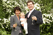 People holding baby and champagne glasses