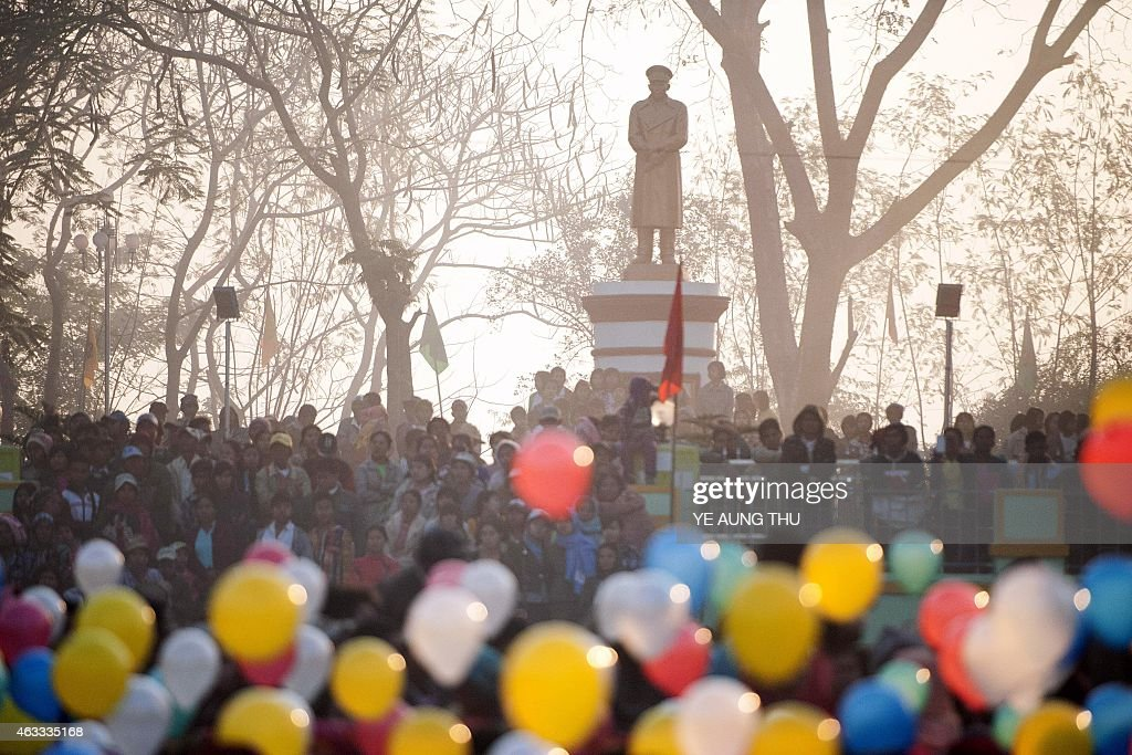 People holding balloons attend a ceremony to mark the 100th birthday of independence hero <a gi-track='captionPersonalityLinkClicked' href=/galleries/search?phrase=Aung+San&family=editorial&specificpeople=812845 ng-click='$event.stopPropagation()'>Aung San</a>, in the remote central Myanmar town of Natmauk on February 13, 2015. Known affectionately as 'Bogyoke', or General, <a gi-track='captionPersonalityLinkClicked' href=/galleries/search?phrase=Aung+San&family=editorial&specificpeople=812845 ng-click='$event.stopPropagation()'>Aung San</a> is adored in Myanmar and credited with unshackling the country from colonial rule and embracing its ethnic minorities in a vision of unity that unravelled catastrophically in the military-dominated decades that followed his 1947 assassination.