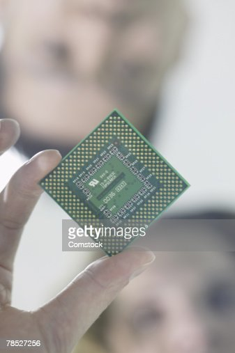 People holding computer chip