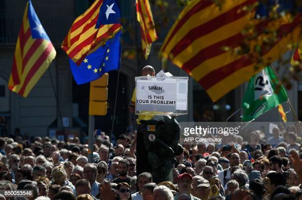 People holding 'Esteladas' and a symbolic ballot box attend a protest in Barcelona on September 20 2017 Thousands took to the streets of Barcelona as...