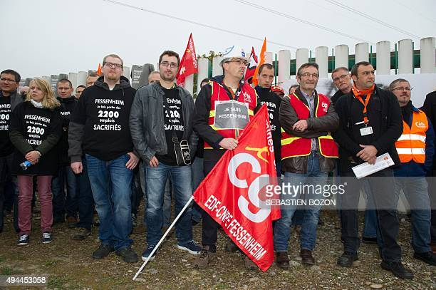 People holding French General Confederation of Labour union flags demonstrate on October 27 in front of the nuclear powerplant of Fessenheim to...
