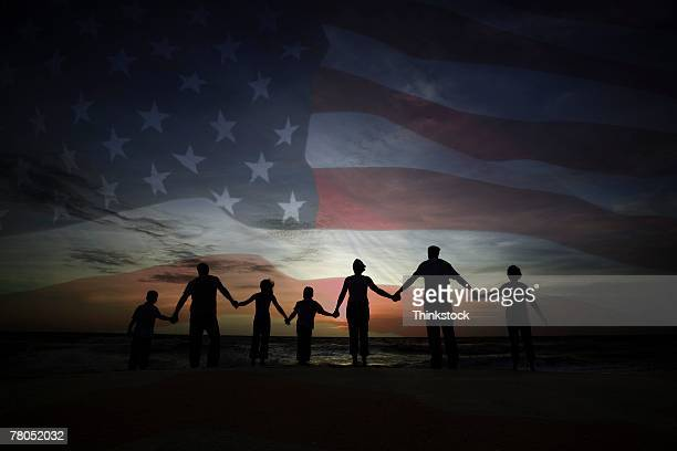 People holding hands with American flag