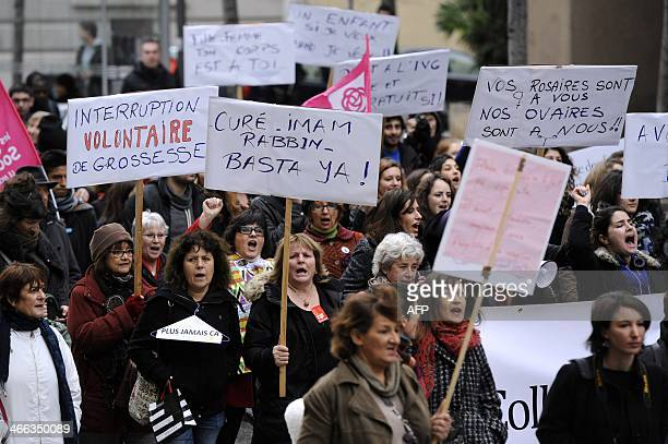 People holding placards take part in a demonstration on February 1 2014 in Marseille to protest against a Spanish legislation yet to pass parliament...
