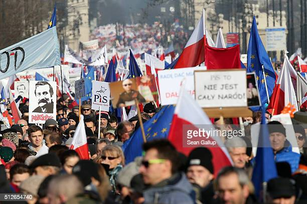 People holding Polish and European Uniion flags participate in a prodemocracy march on February 27 2016 in Warsaw Poland Tens of thousands of people...