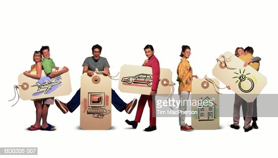 People holding tags with consumer themes illustrations (Composite) : Stock Photo