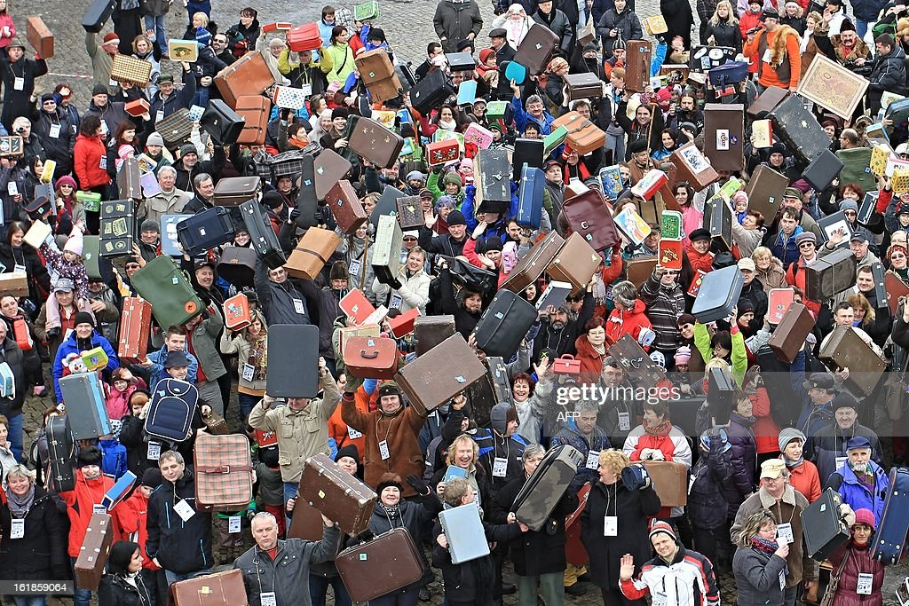 People holding up suitcases gather on Masaryk Square in Zabreh, central Moravia, Czech Republic, on February 17, 2013, for an attempt to bring a record number of suitcases to one place. 579 people with suitcases came to the place to honor Czech adventurer, traveller and gold digger Jan Eskymo Welzl. The record will be officially registered in the Guinness Book of Records. AFP PHOTO / RADEK MICA