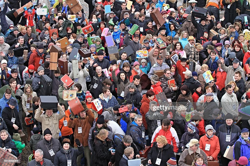 People holding up suitcases gather on Masaryk Square in Zabreh, central Moravia, Czech Republic, on February 17, 2013, for an attempt to bring a record number of suitcases to one place. 579 people with suitcases came to the place to honor Czech adventurer, traveller and gold digger Jan Eskymo Welzl. The record will be officially registered in the Guinness Book of Records.