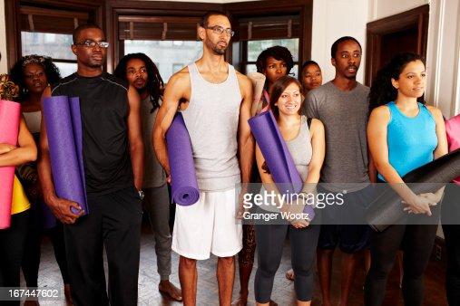 People holding yoga mats : Stock Photo