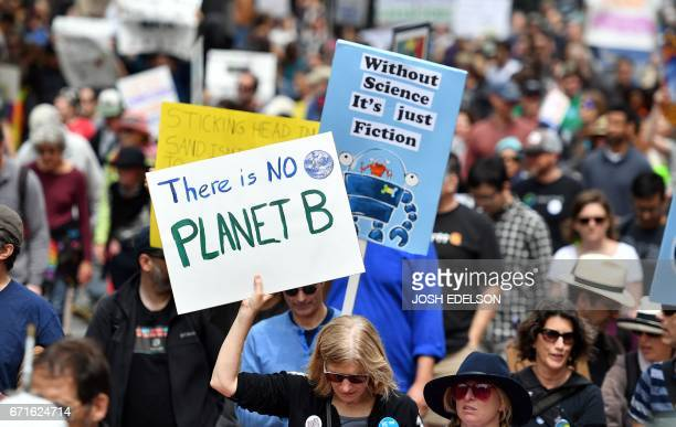 People holds up signs as thousands of people participate in the March for Science in San Francisco California on April 22 2017 Day Thousands of...