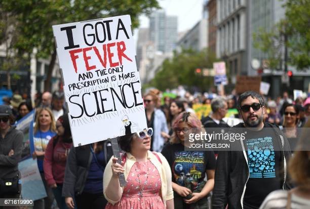 People holds up signs during the March for Science in San Francisco California on April 22 2017 Thousands of people joined a global March for Science...