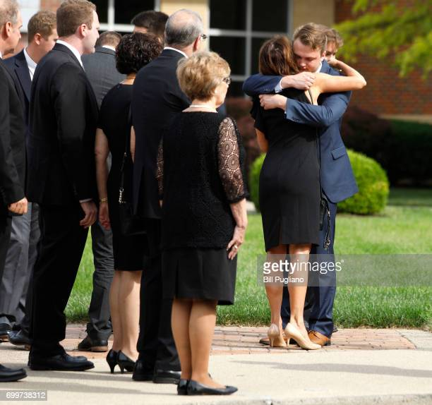 People hug at the funeral service of Otto Warmbier outside Wyoming High School June 22 2017 in Wyoming Ohio Otto Warmbier the 22yearold college...