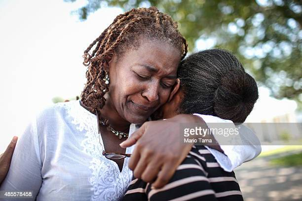 People hug following a jazz funeral ceremony at Dillard University on August 28 2015 in New Orleans Louisiana The traditional ceremony was conducted...