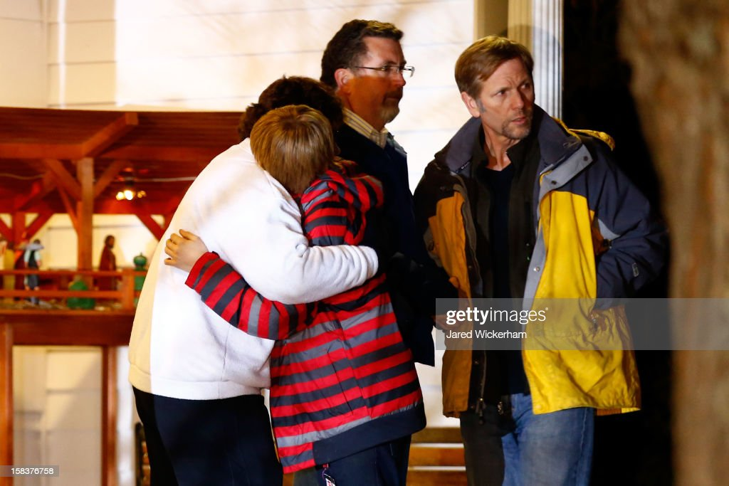 People hug outside of the Newtown United Methodist Church on December 14, 2012 in Newtown, Connecticut. Twenty-seven are dead, including 20 children, after a gunman identified as Adam Lanza in news reports, opened fire in the Sandy Hook School in Newtown. Lanza also reportedly died at the scene.