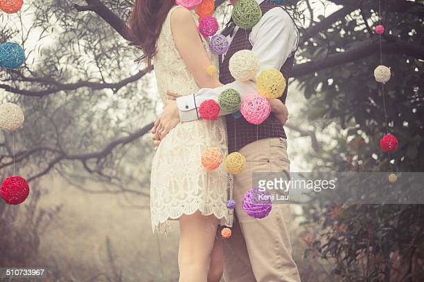2 people hugging with vine ball
