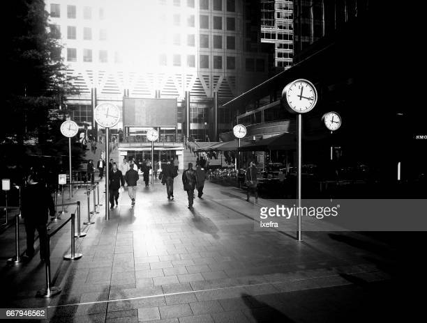 People hurrying through a street in  Canary Wharf, London.