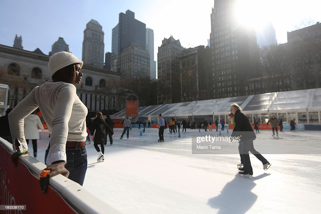 People ice skate in the warm weather in Bryant Park on January 29, 2013 in New York City. Following an Arctic cold spell, temperatures reached close to 50 degrees in the city today and are expected to approach 60 tomorrow.