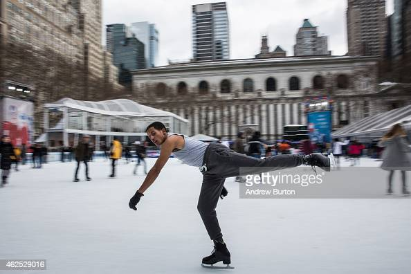 People ice skate on a temporary ice skating rink set up in Bryant Park as part of a winter carnival on January 30 2015 in New York City The carnival...