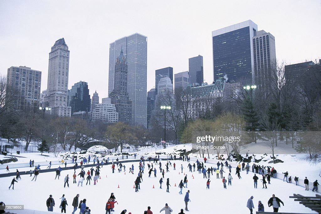 People ice skating in central park : Stock Photo