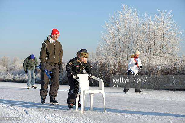 People ice-skating on a lake in the Netherlands