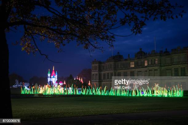 People illuminations as they enjoy the spectacle at the opening night of annual Festival of Light at the Elizabethan Longleat House on November 3...