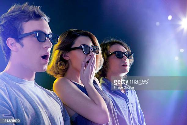 People in 3D glasses looking towards light