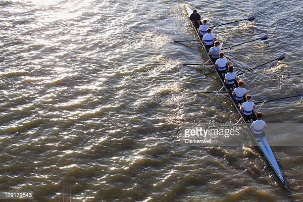 People in a canoe oaring