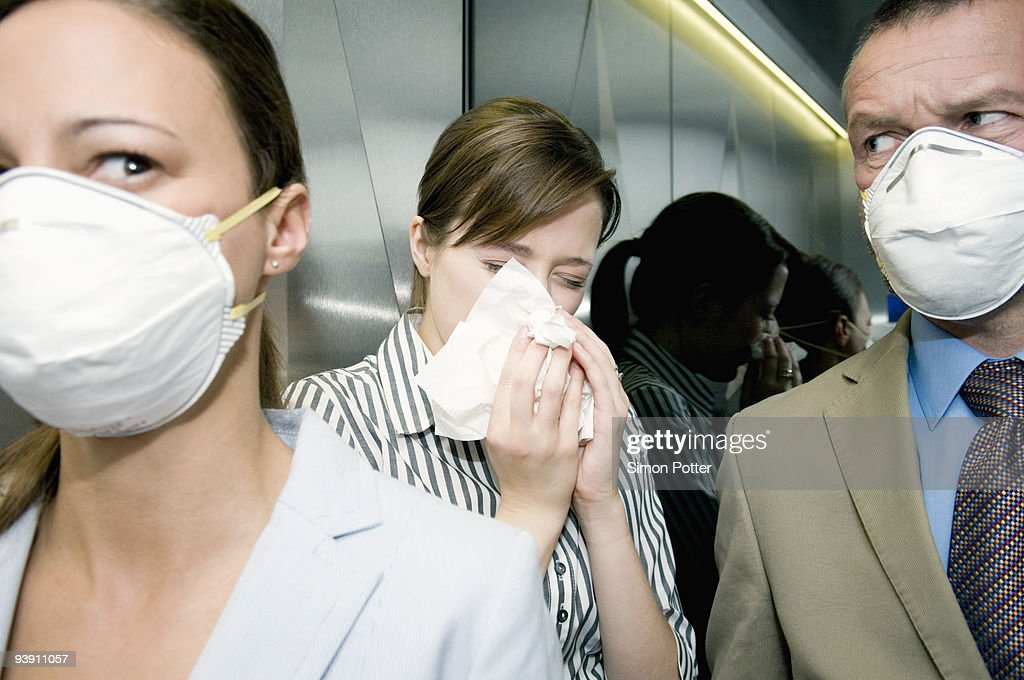 People in a lift during a health alert