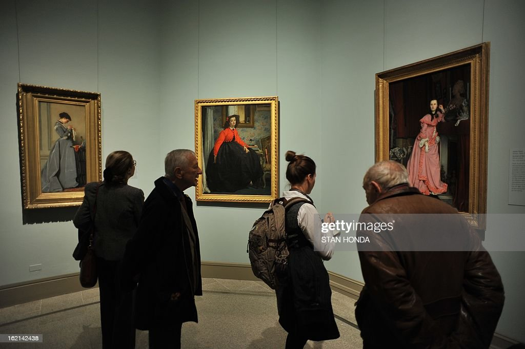 People in a media preview look at 'Penelope' ca. 1868 (L) by Charles-Francois Marchal, 'Portrait of Mademoiselle L.L., 1864' by James Tissot (C) and 'Portrait of the Marquise de Miramon, 1866' (R) by James Tissot in the exhibition 'Impressionism, Fashion, and Modernity' February 19, 2013 at The Metropolitan Museum of Art in New York. The look at the role of fashion in the works of the Impressionists and their contemporaries shows 80 major paintings with period costumes, accessories, fashion plates, photographs, and popular prints. AFP PHOTO/Stan HONDA