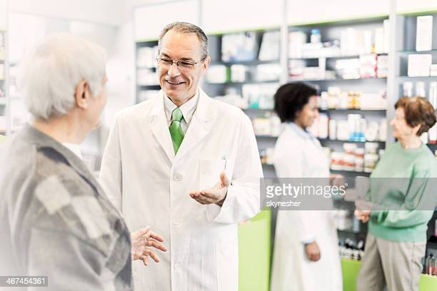 People in a pharmacy.