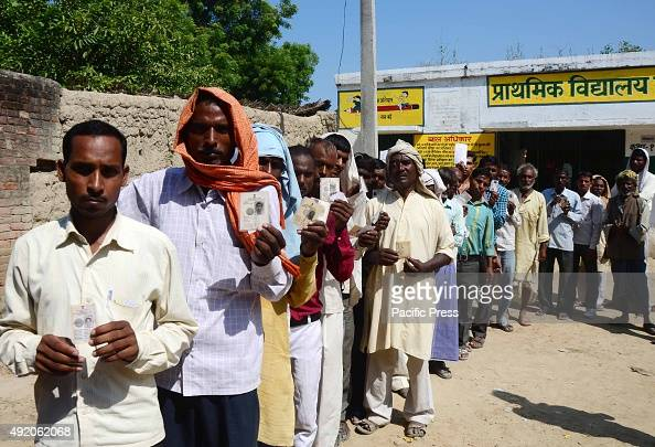 People in a queue to cast their vote for Jila Panchayat Election at Meja near Allahabad