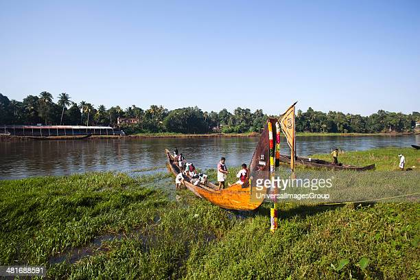 People in a snake boat at riverside Aranmula Kerala India