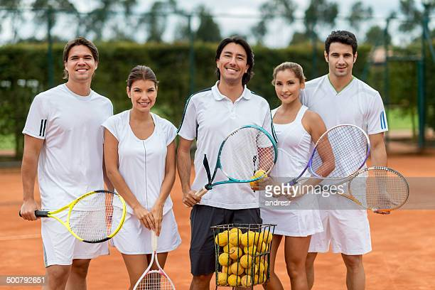 People in a tennis lesson