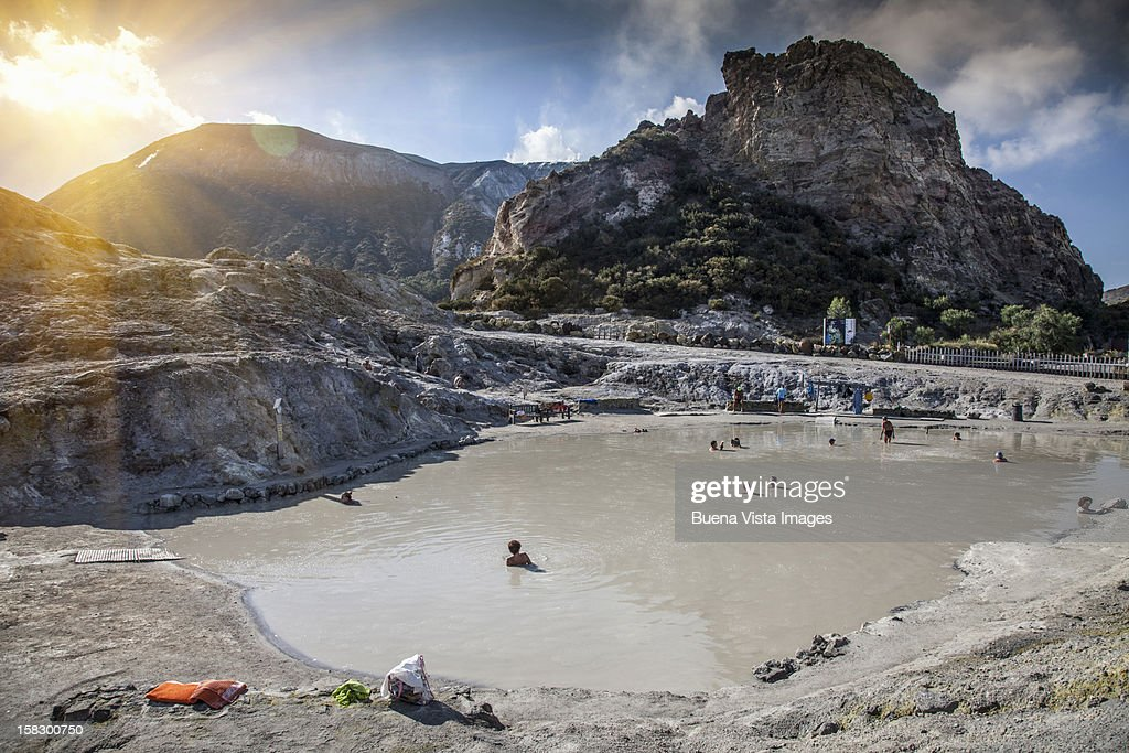People in a therapeutic mud pool : Stock Photo