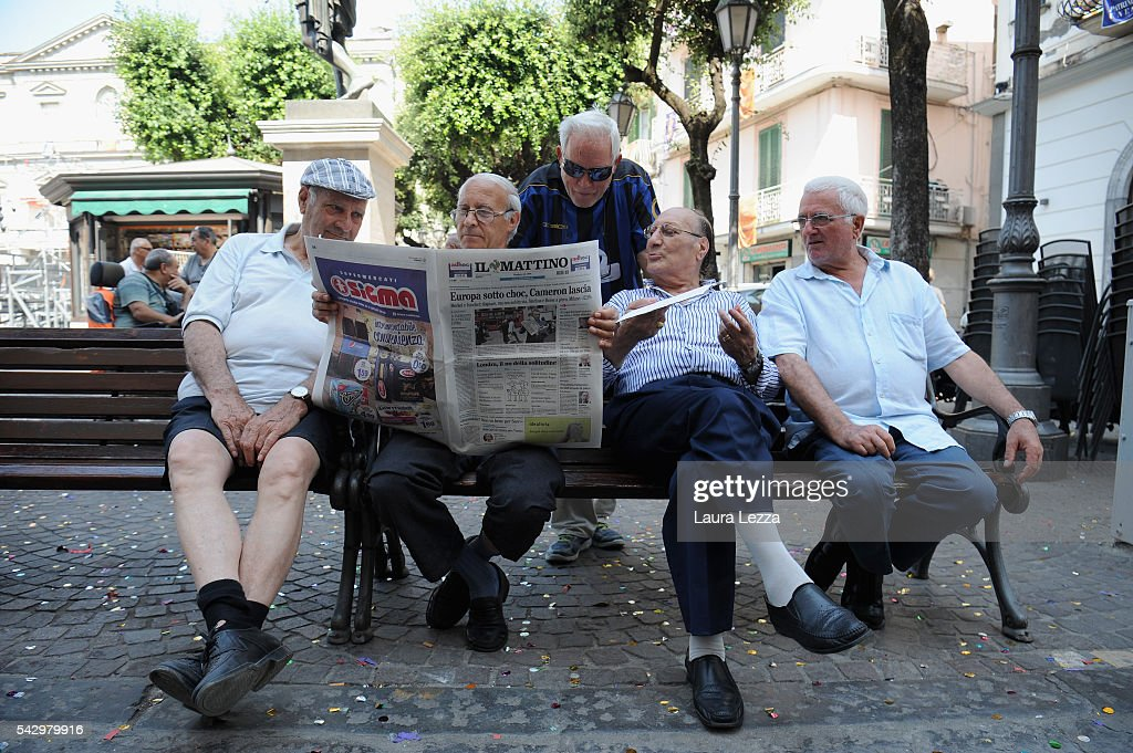 People in a town in southern Italy read in a square a newspaper declaring about Brexit and UK leaving the European Union on June 25, 2016 in the town of Nola near Naples, Italy. The results from the historic EU referendum has been declared and the United Kingdom has voted to leave the European Union.