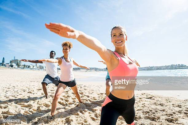 People in a yoga class at the beach