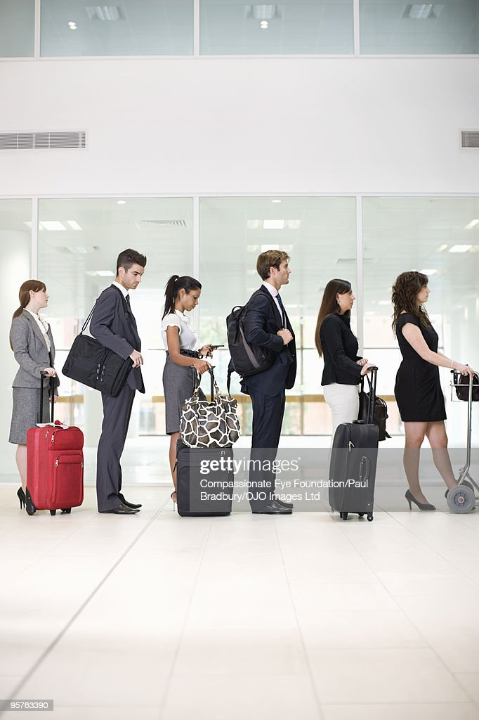 People in airport lineup