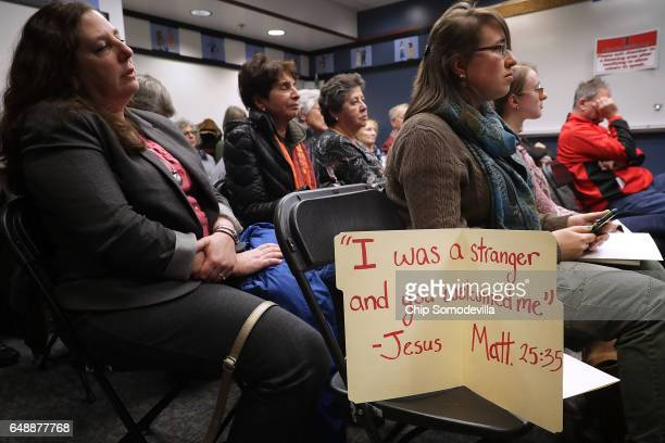 People in an overflow room listen to testimony during a hearing on a propsal to become a 'sanctuary city' at City Hall March 6 2017 in Rockville...