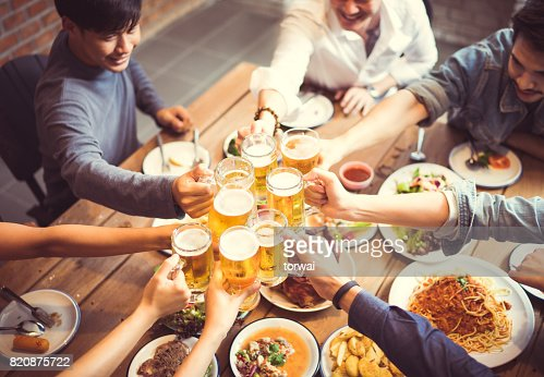 People in asian are celebrating the festival they clink glasses beer and dinner happy.top view : Foto de stock
