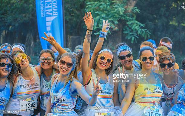 People in celebration with colorful powder in The Color Run by Desigual in Barcelona Catalonia May 18th of 2014