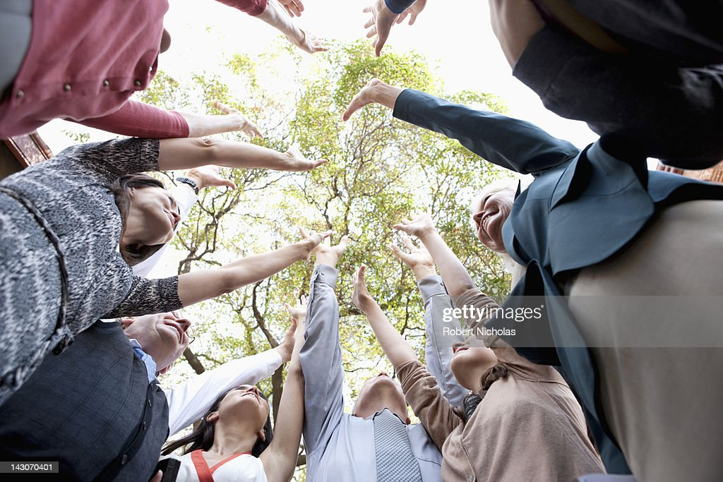 People in circle cheering together : Stock Photo