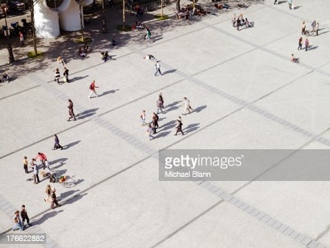 people in city from above, aerial