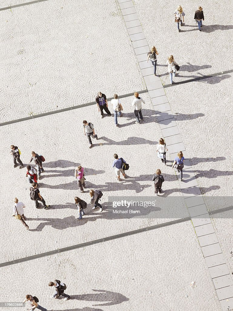 people in city seen from above, aerial
