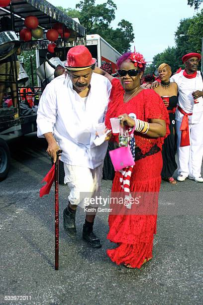 People in Costume playing Mas and dancing in the street at the Brooklyn J'Ouvert Carnival in NYC USA in 2014 spreading Trinidad Carnival and West...