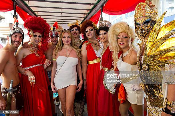 People in costume pose for apicture during the Gay Pride parade on June 27 2015 in Milan Italy Yesterday the United States Supreme Court legalized...