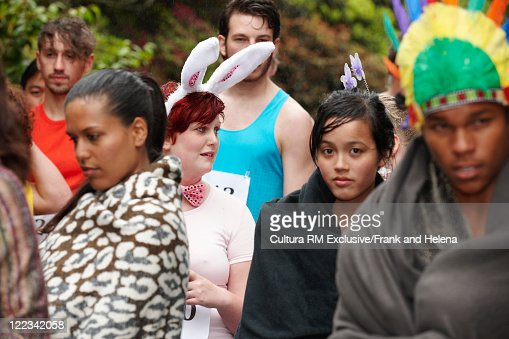People in costume together outdoors : Stock Photo