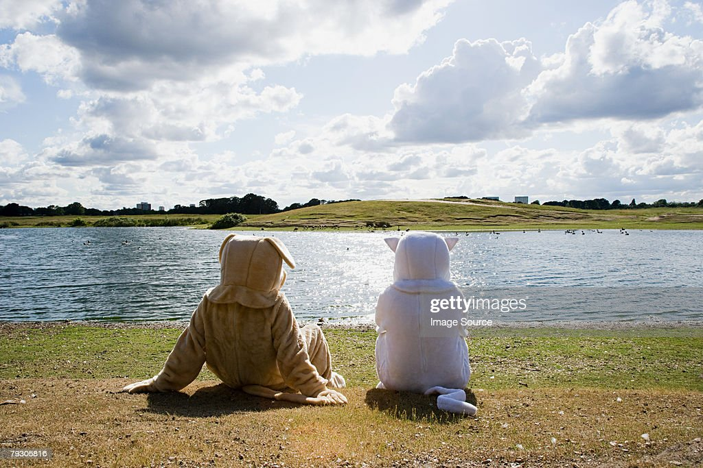 People in costumes by lake : Stock Photo