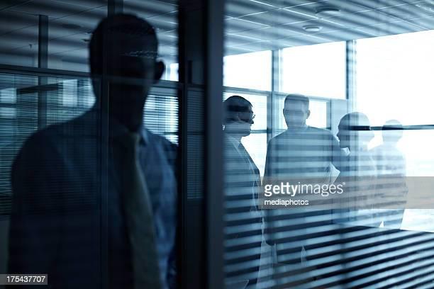 People in dark room