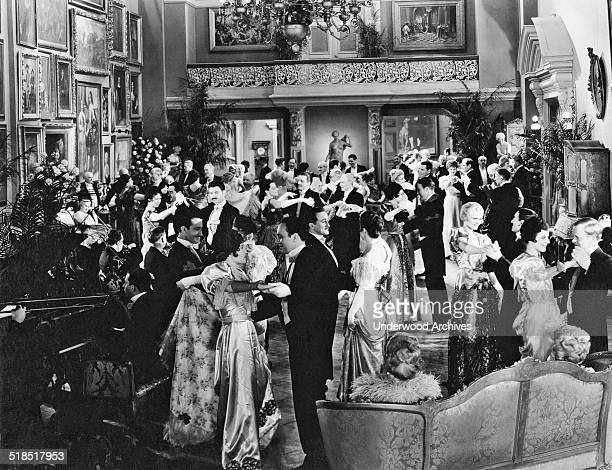 People in elegant attire dancing at a formal party Hollywood California mid 1920s
