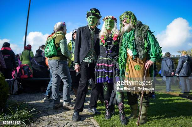 People in fancy dress at Chalice Well Glastonbury where Beltane festivities are taking place on May Day