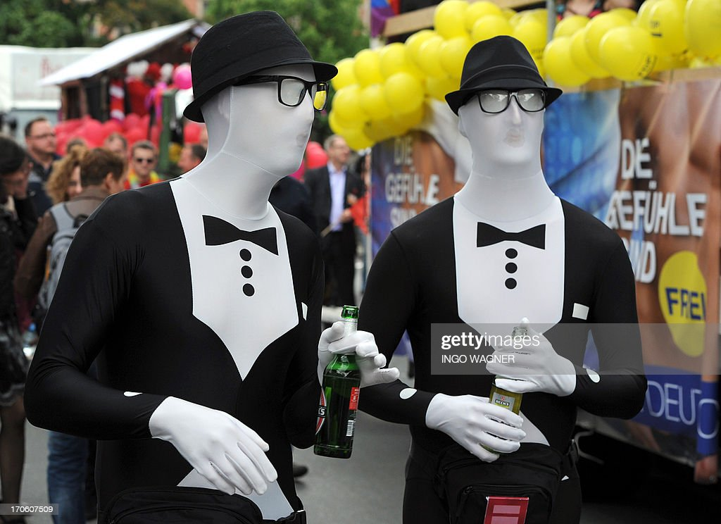 People in fancy dresses parade throught the streets of Oldenburg, western Germany, as they take part in the Christopher Street Day (CSD) on June 15, 2013. Gays and lesbians demonstrate at the Christopher Street Day for equal rights.